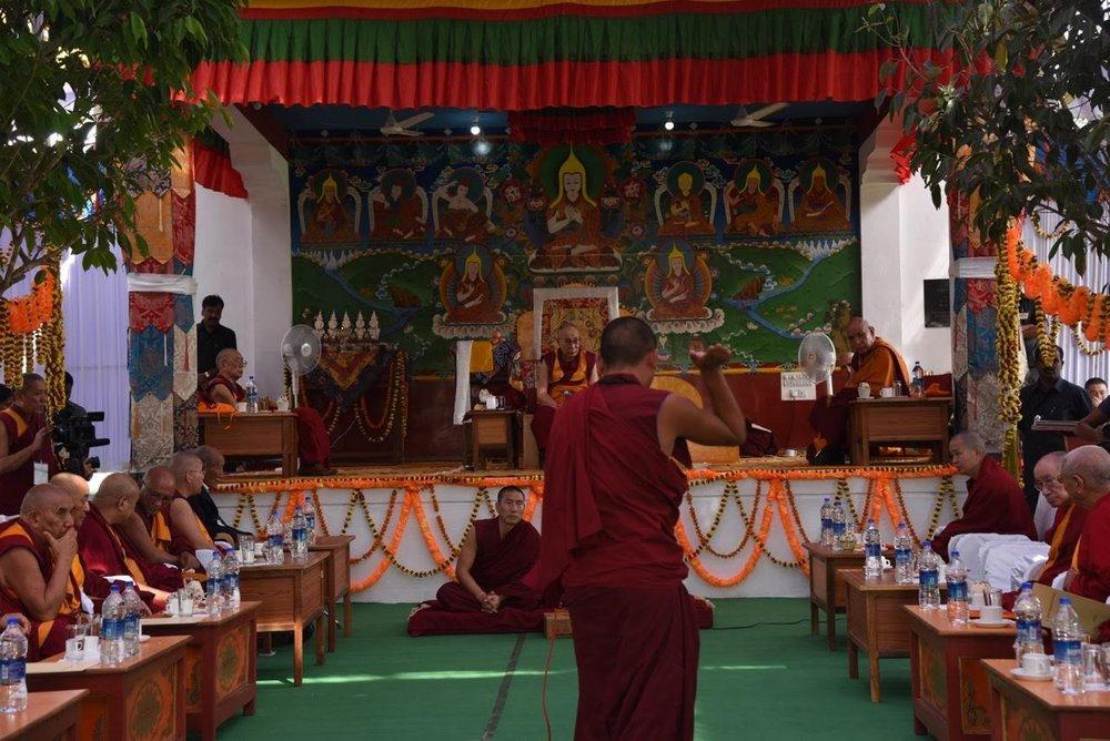 Rato monks debate before His Holiness as well as Ganden Trisur Rinpoche, Jangtse Choeje Rinpoche, Ling Rinpoche, Kundeling Rinpoche and the abbots of the great Tibetan Monastic Universities and Tantric Colleges. Photo by Tanya Agarwal