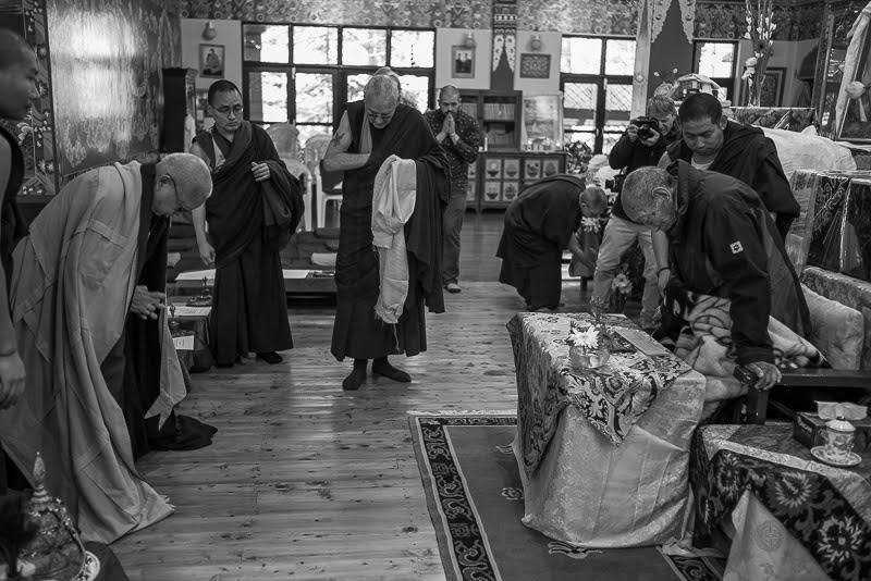Zopa Rinpoche makes prostrations which Khyongla Rinpoche stands for