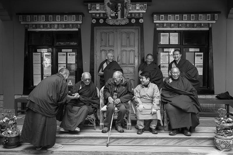 Zopa Rinpoche is seated