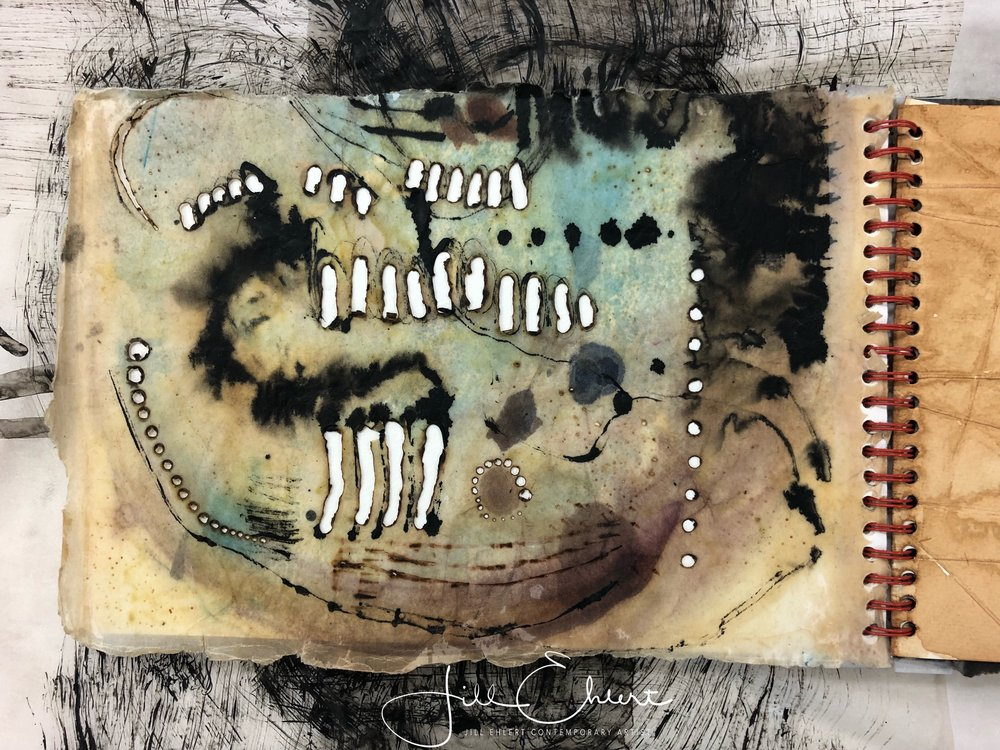 Beeswax, burning holes, inks.