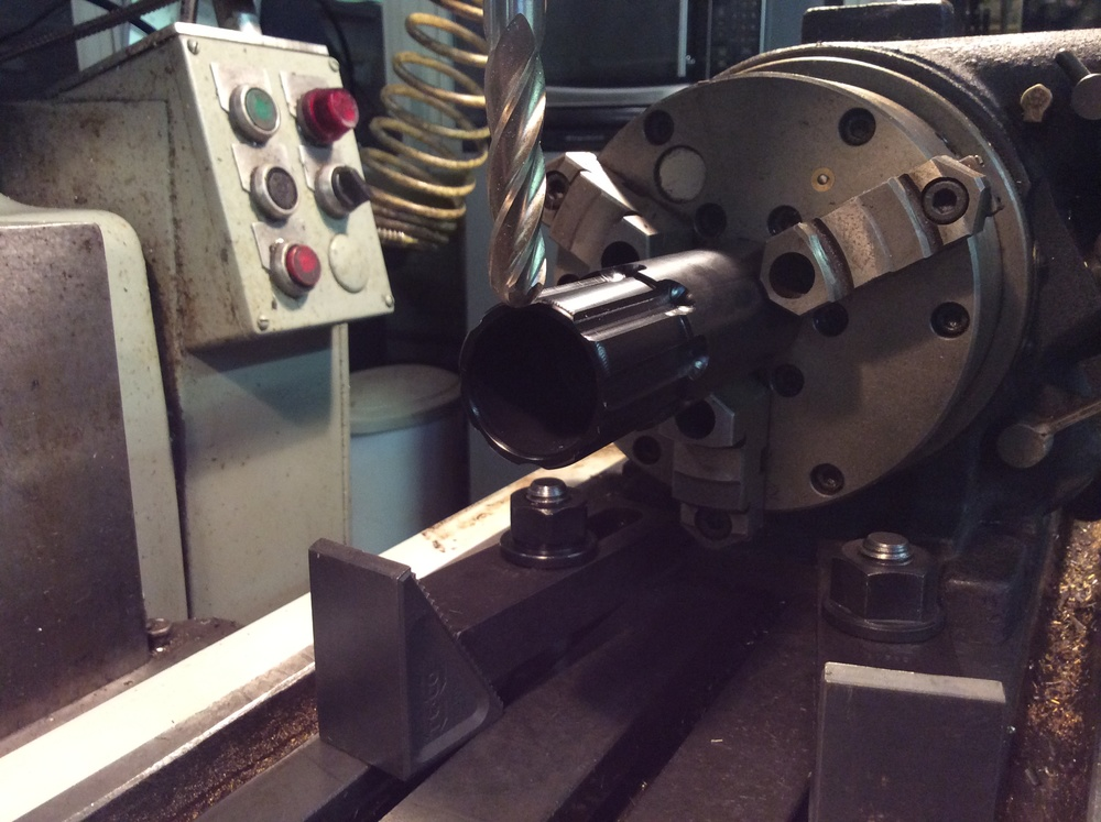 Using an indexing head to machine a grip detail.