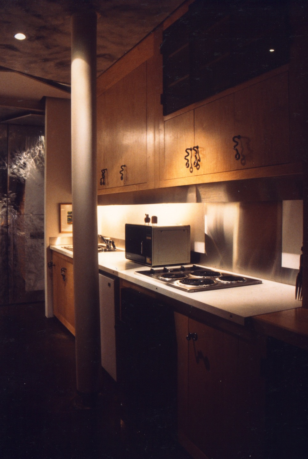 View of Kitchen with Aluminum Storage Hallway Wall Beyond