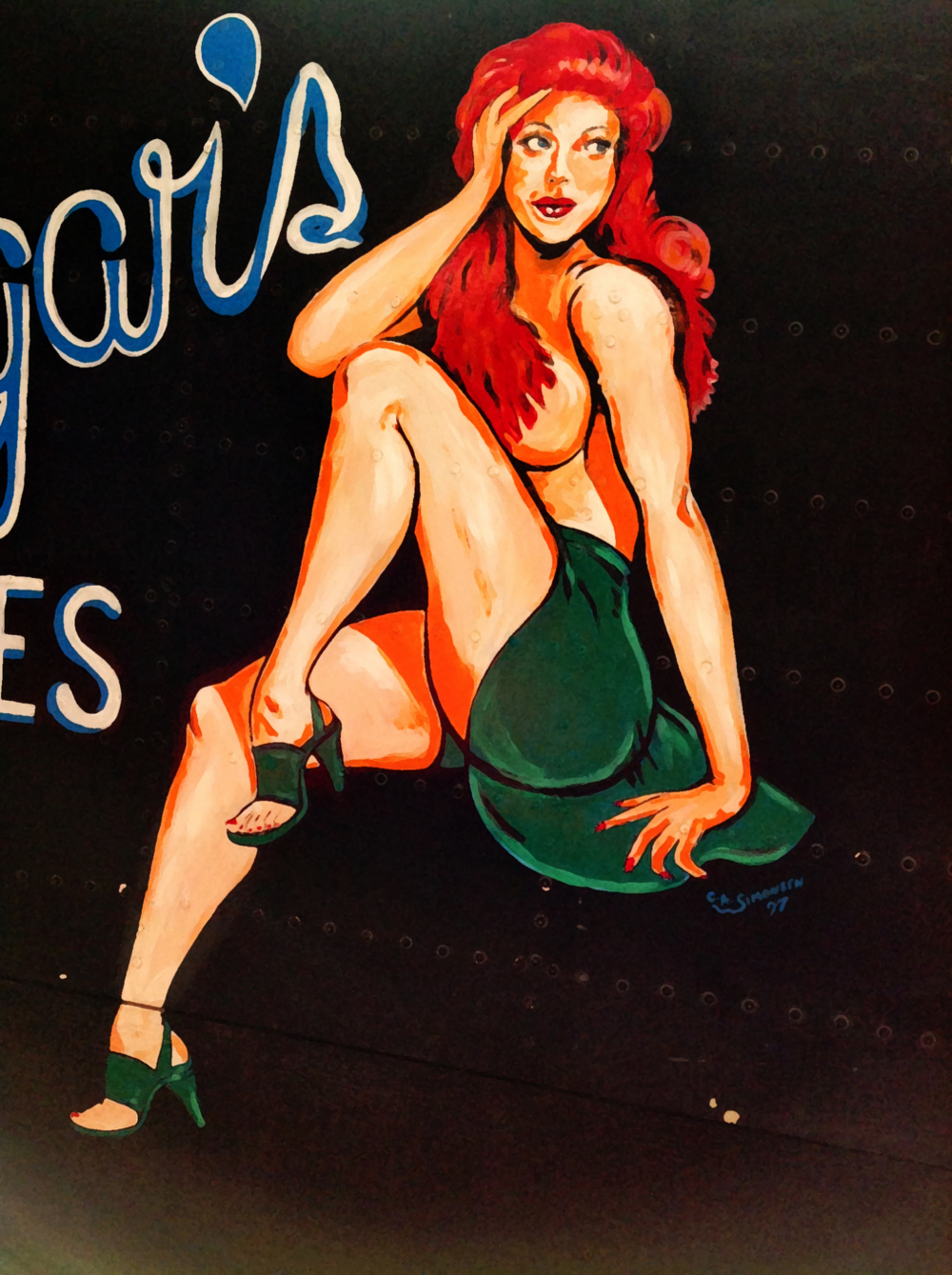 "Varga Pin-Up Girl painting on the side of a Lancaster WW2 bomber cockpit section replica in the Nanton Aviation Museum in Nanton, Alberta. The painting is a replica of what was on Lancaster KB-864 of the 428 Squadron RCAF. The figure is based on the popular ""Varga"" pin-up girl who was featured in the January 1945 edition of Esquire magazine. The 'S' is for Sugar-Sugar's Blues a popular wartime dance tune at the time."