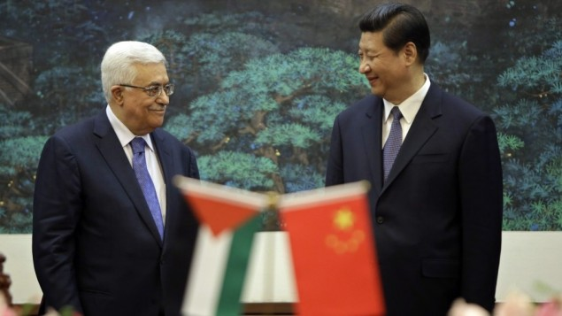 Palestinian Authority President Mahmoud Abbas (left), China President Xi Jinping (right). Photo credit: AP/Jason Lee)