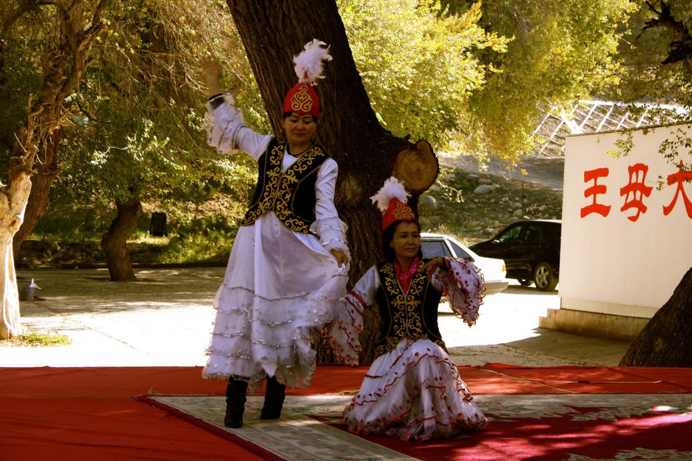 Dancers in Kazakh village near the Heavenly Lake in Xinjiang. (Credit: Kendrick Kuo, author, 2012)