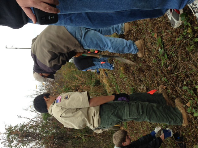 Scouts plant chestnut saplings on a slope near the Confluence of the north and south forks of Peachtree Creek.
