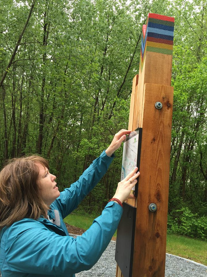 Paige Singer, DeKalb County Parks Project Manager personally fitted the new panel to the Zonolite trailhead.