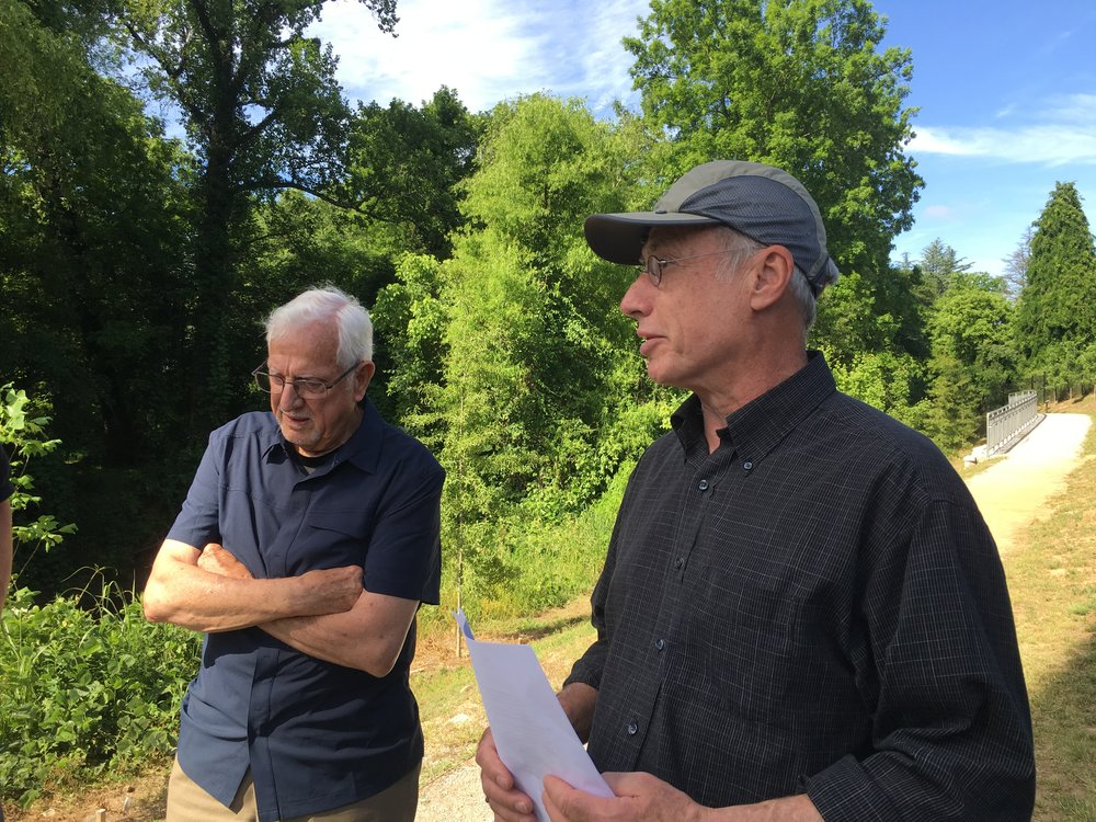 Dave Butler in his birding cap shares a tale along the Cheshire Farm Trail with South Fork Board Chairman Bob Kerr.