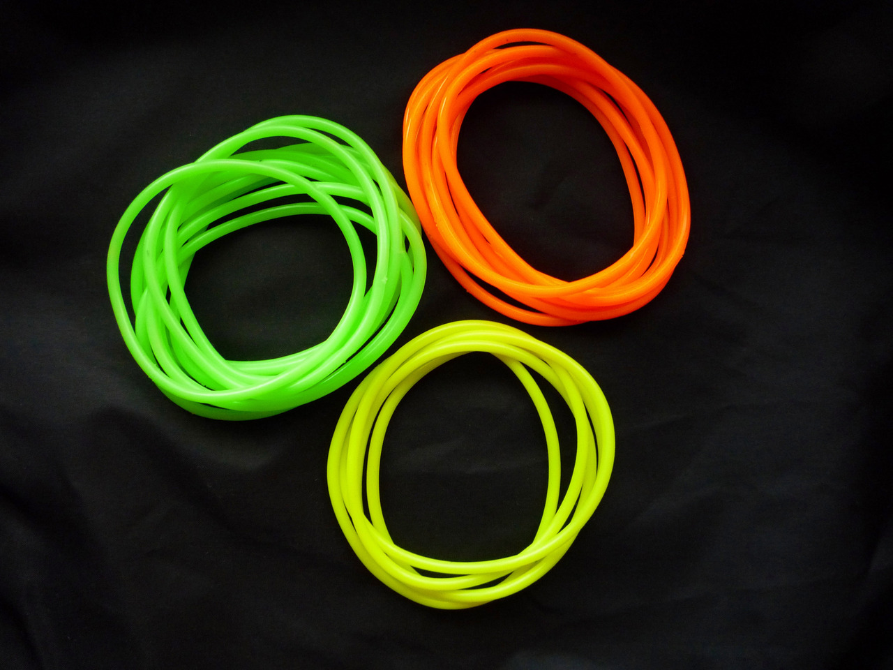 i'm working on a logo right now and it had me downloading 80s colors this morning. i found this picture, and man did i love these bracelets.