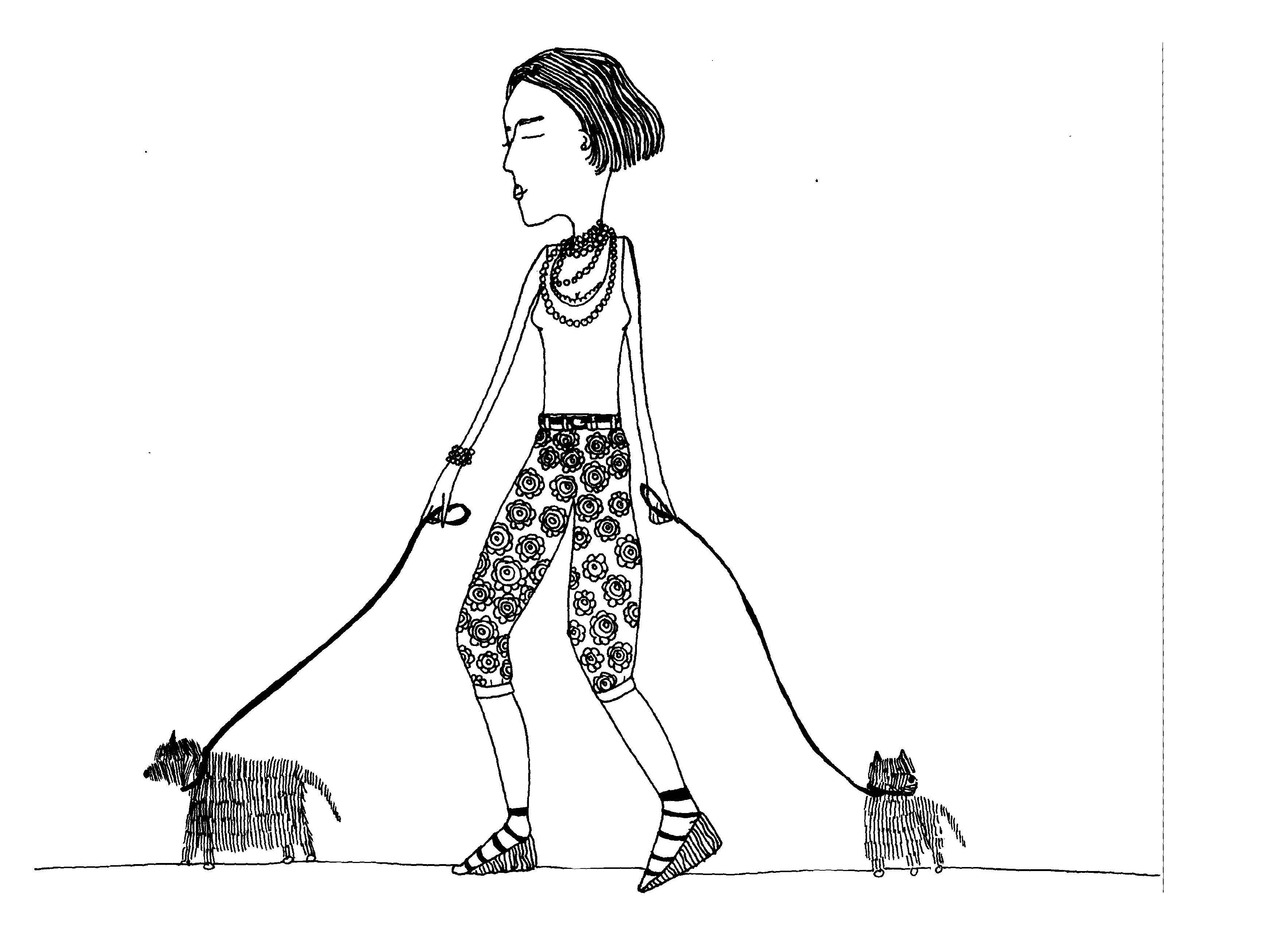 lady with pearls walks two dogs