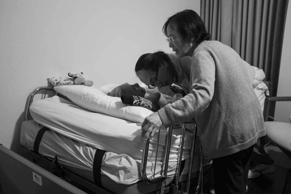 My uncle Peter and aunty Penny arrived on October 1, 2015 from Toronto, Canada. Peter bends down to listen to his mom whisper to him from her bed.
