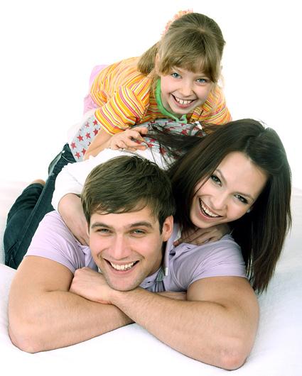 Happy Family on White Bed Isolated ©Poznyakov