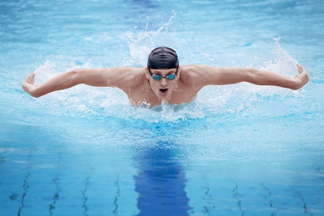 Stock photo of swimmer in cap.