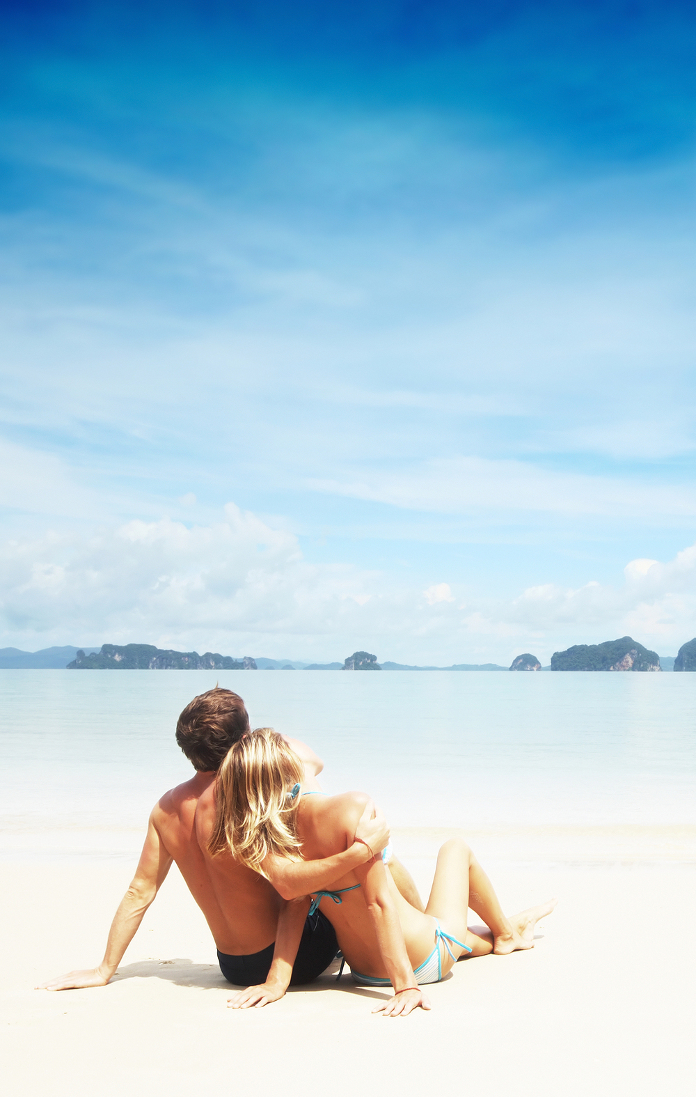 bigstock photo Young couple relaxing on a beach