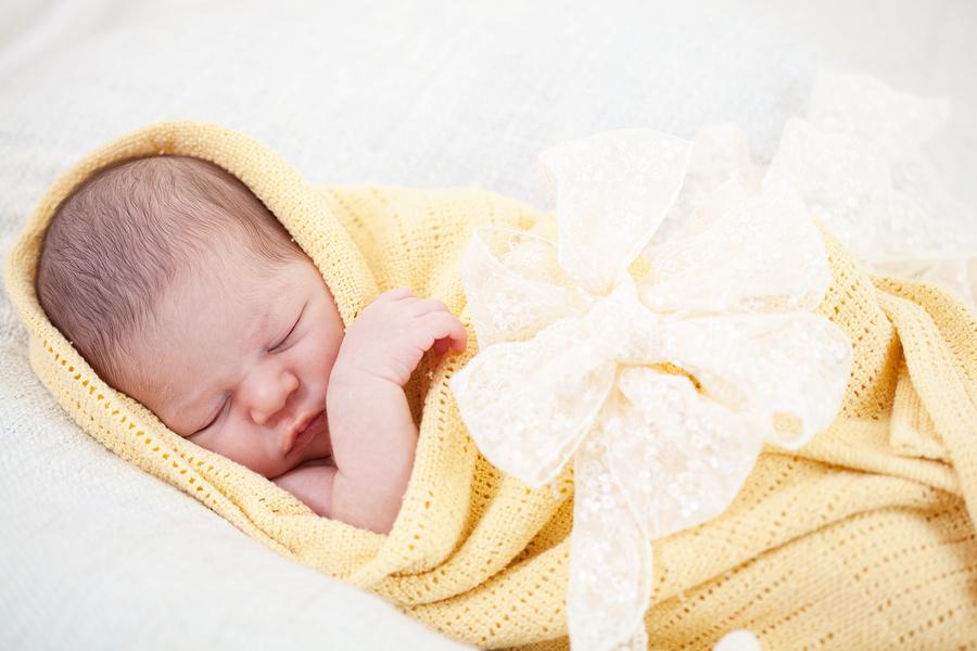 bigstock-sleeping-newborn-baby-wrapped--35695436.jpg