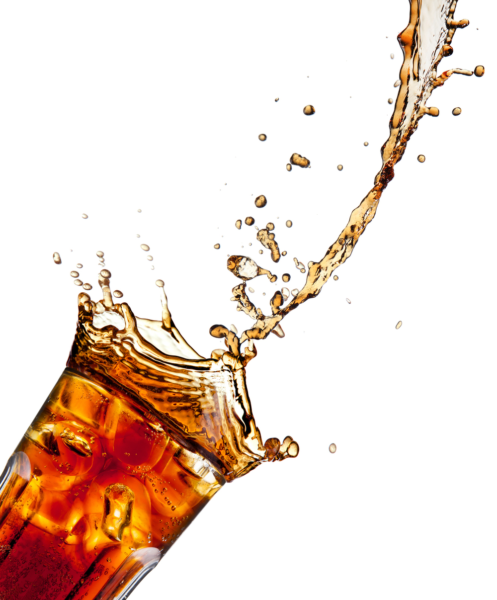 bigstock-Pouring-cola-into-glass-isola-31710560.jpg