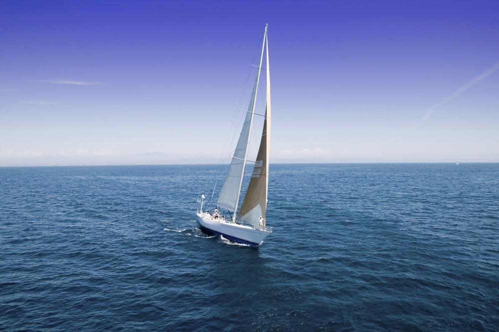 bigstock-Sailboat-at-the-peaceful-blue--46310368.jpg