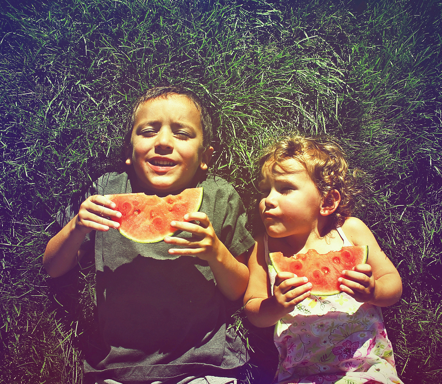 Two children eating watermelon  photo from  graphicphoto