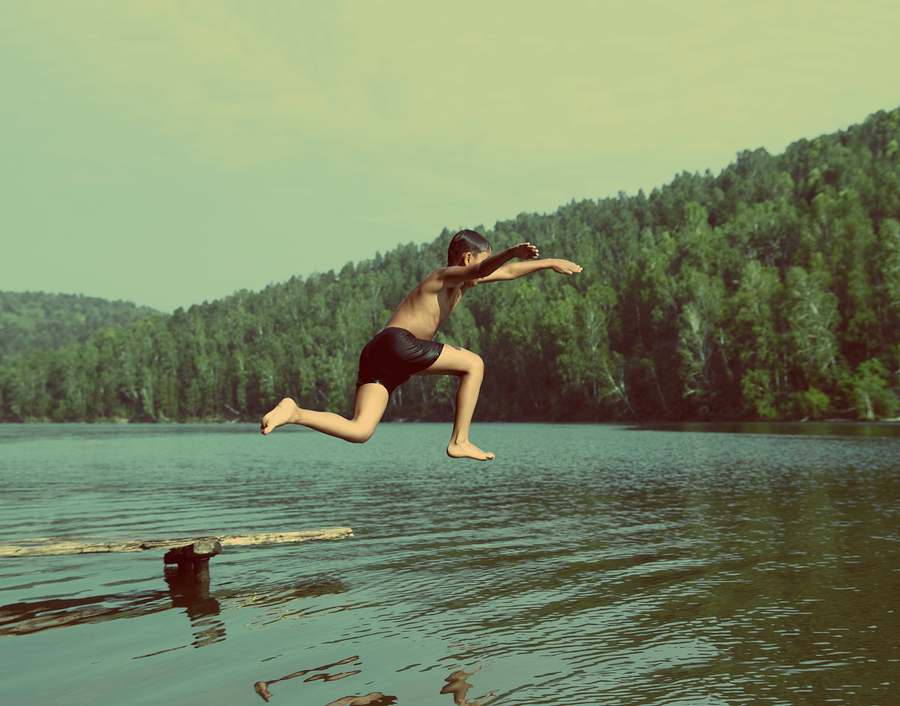 Boy jumping in lake  photo from  Kokhanchikov