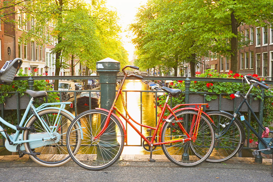 Stock photo of bikes on bridge in Amsterdam.