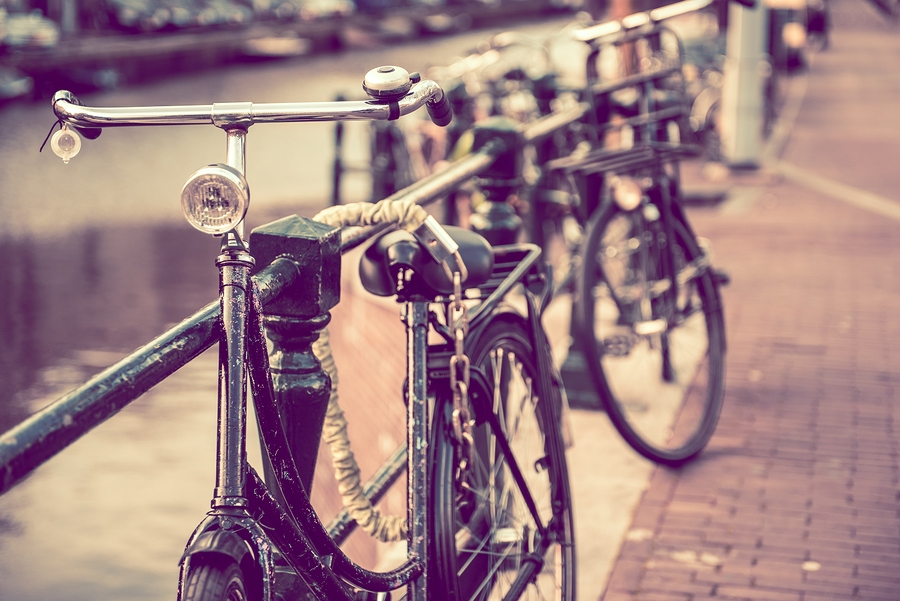 Image of secured old bikes in Amsterdam  | by  ginton    Pit stop. (Just a friendly reminder to lock up your bike, of course. Besides, we just really love this photo.)