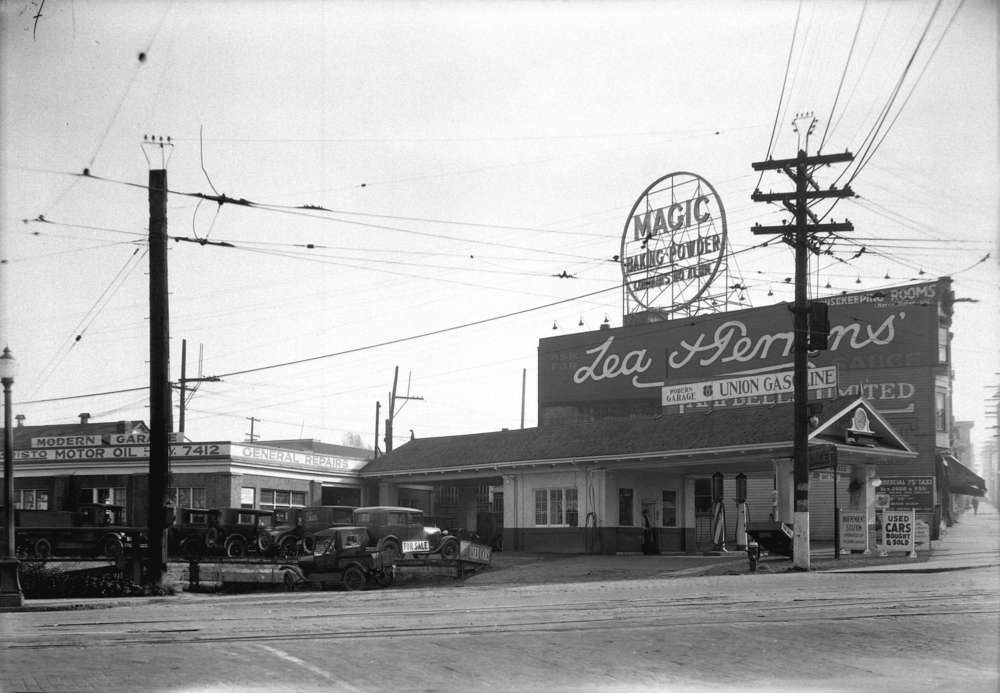Taken for Duker and Shaw Billboards Ltd. Modern Garage, Granville Street, between 4th and 5th. Courtesy of Vancouver Archives.