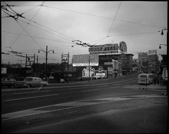 Billboards at the south end of the Granville Street Bridge, 1961. © VPL Archives
