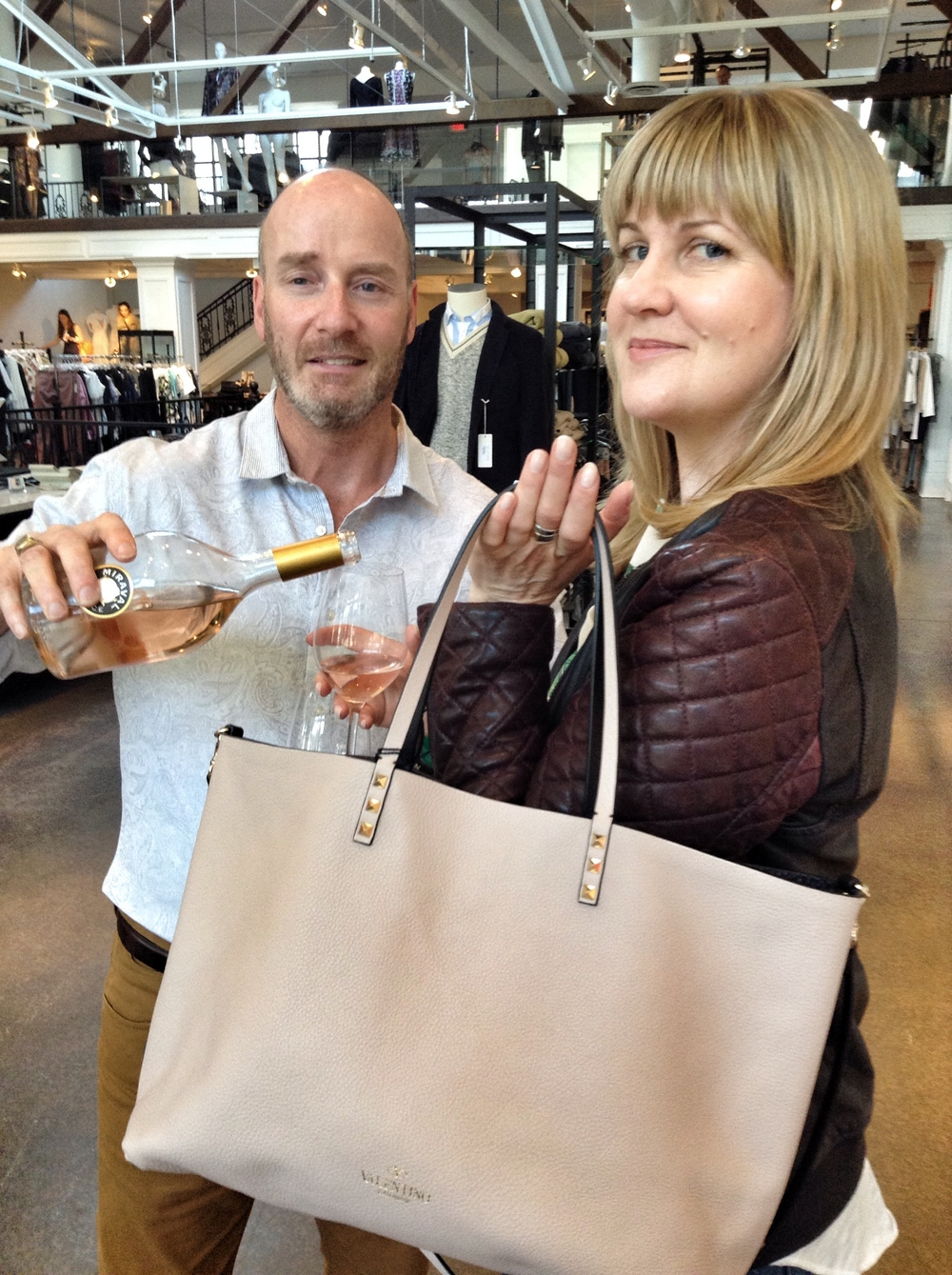"Being ""topped up"" by Boboli Manager Ed Brown - always coordinate your bag with your beverage."