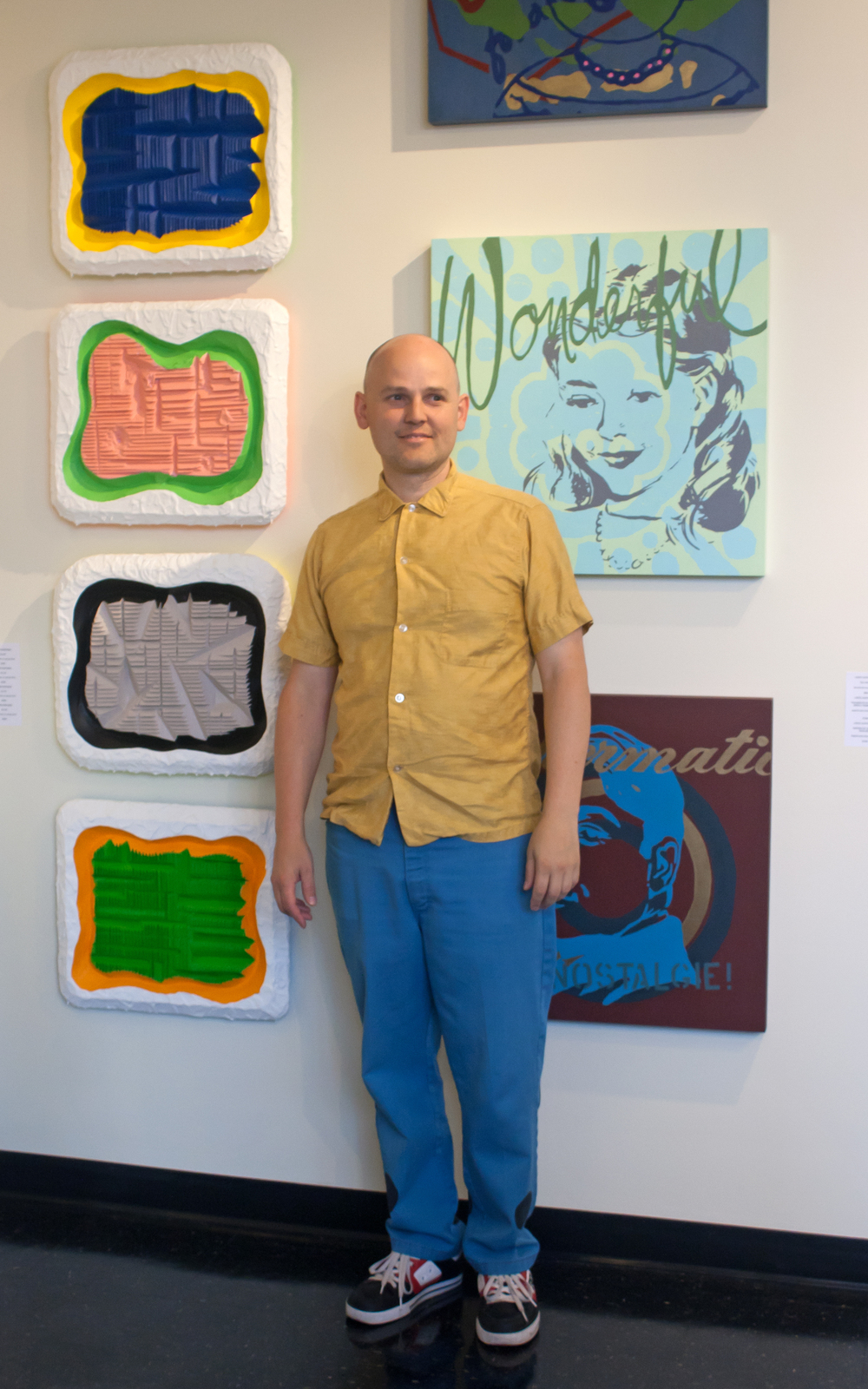 Polychrome003  Shawn Shepherd with his own works.jpg