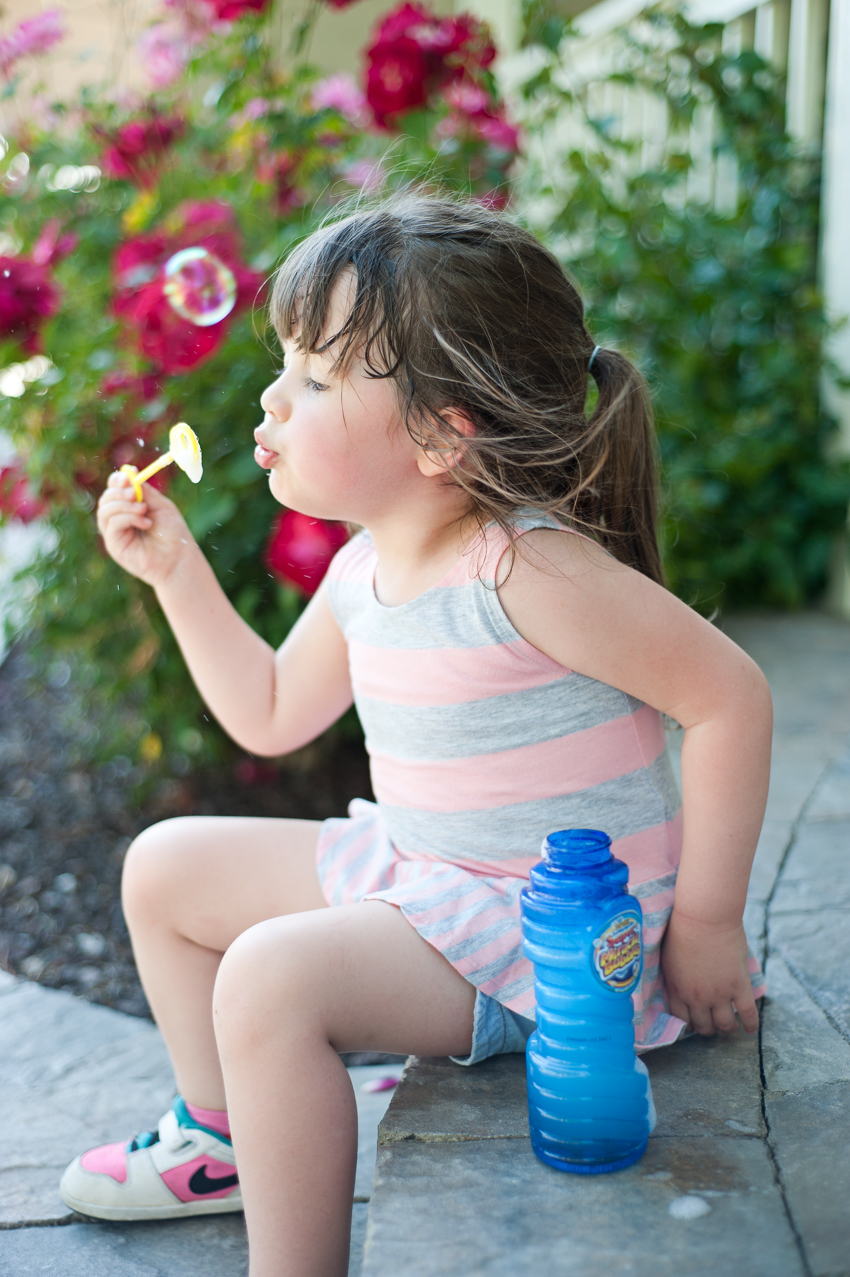 Blowing bubbles on the front porch