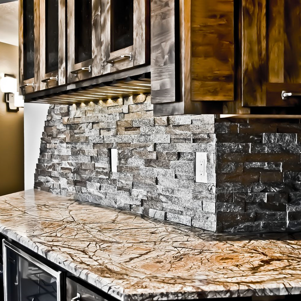 Granite counter and redesigned bar with stone backsplash