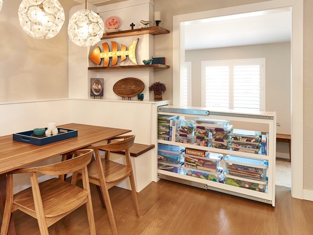 Interior design built-in open shelves seating and white cabinets, globe flower lighting