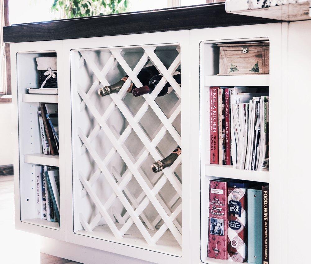 custom bookshelf wine rack in kitchen island in denver colorado by 328 interior design