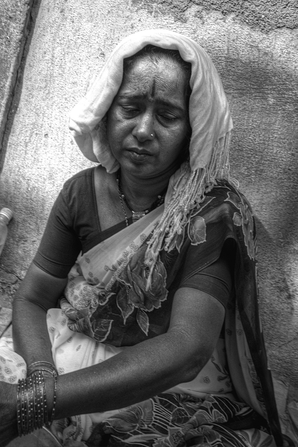 Sad woman in Mumbai, India