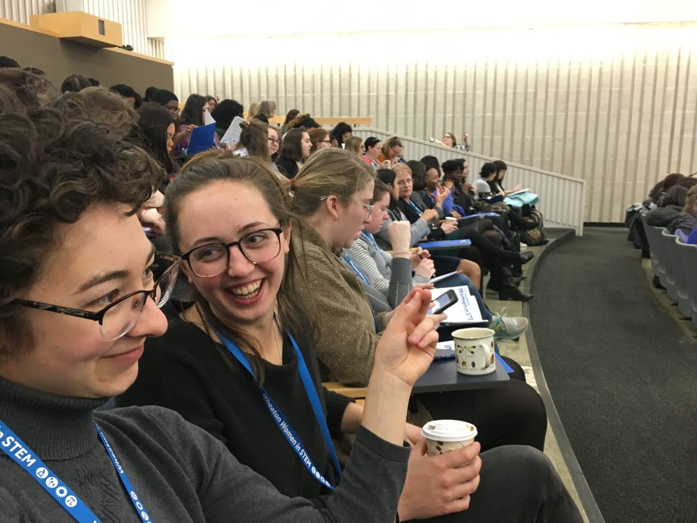 """Sarah Gross and Ferne Johansson, both '18, chat before the start of the """"Imposter Syndrome"""" lecture."""