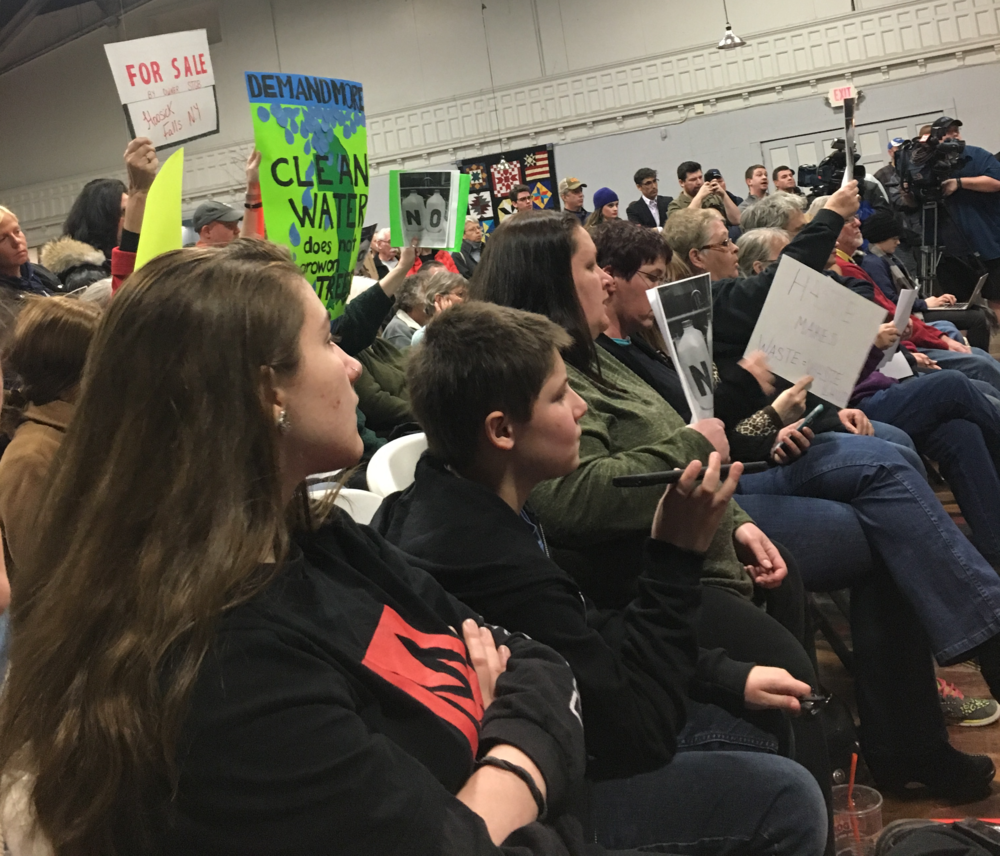Protesters at a Hoosick Falls Village Board meeting in spring 2017. Photo by Jorja Rose.