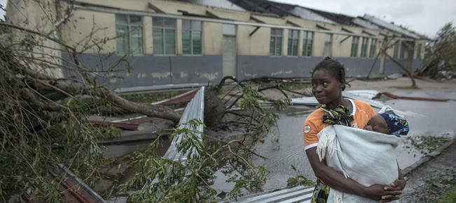 Mozambique-cyclone-woman-holding-bag-main_article_image.jpg
