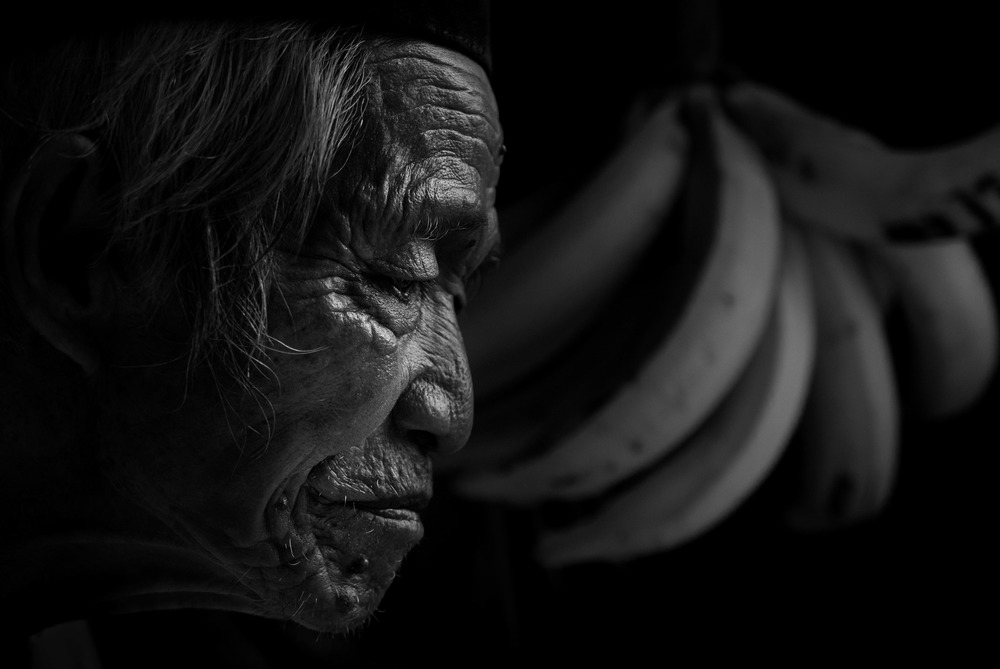 Portrait of 101 year old Javanese Banana Seller shot at 75mm f/2.8 max aperture