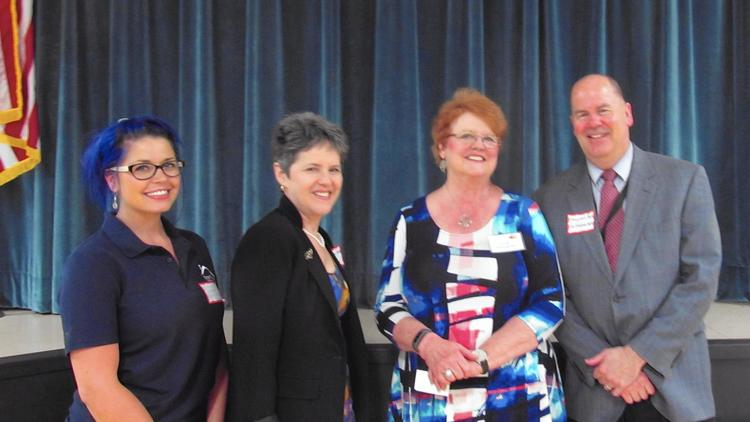 From left, Brittany Klemmer with Hope House; Loren Weisman, development director of Chrysalis House; Linda Cunningham, Heritage Harbour Women's Club vice president for programs; and Christopher McCabe, executive director of Chrysalis House. Courtesy photo/Bea Parker/HANDOUT