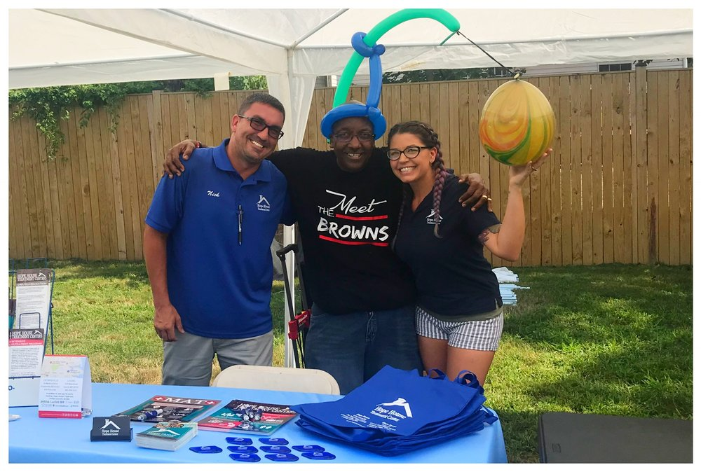 Staff members Nick Clemente, Raynaldo Brown and Brittany Klemmer at the 17th Annual Oxford Landing Back to School Celebration on August 29th.