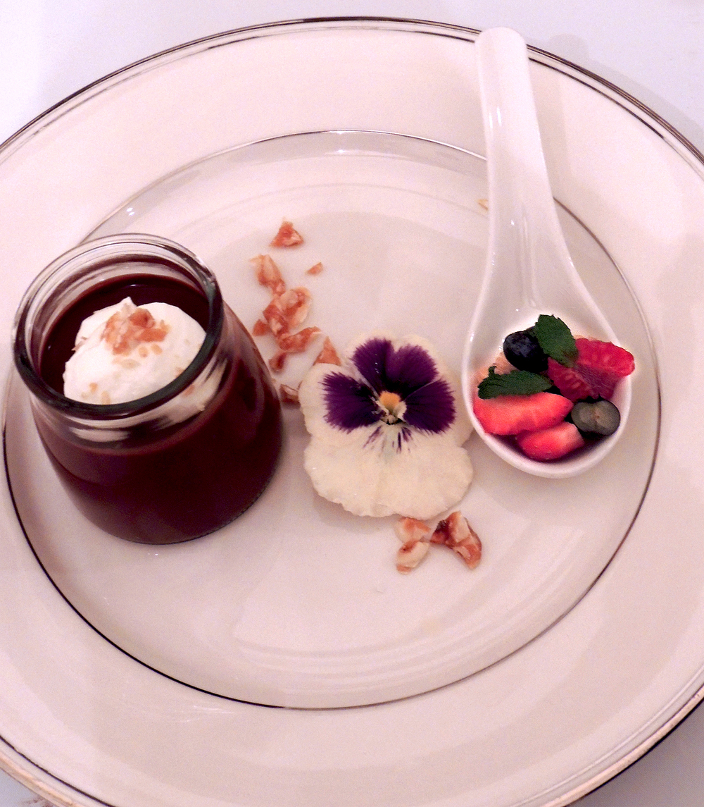 Chocolate pots de créme, candied pansies, hazelnut brittle, mixed berries