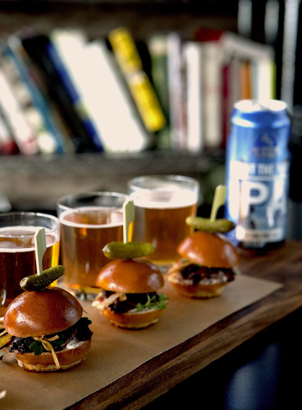 Short Rib Slider with Horseradish Cream and Fried Leeks on Brioche Buns with IPA