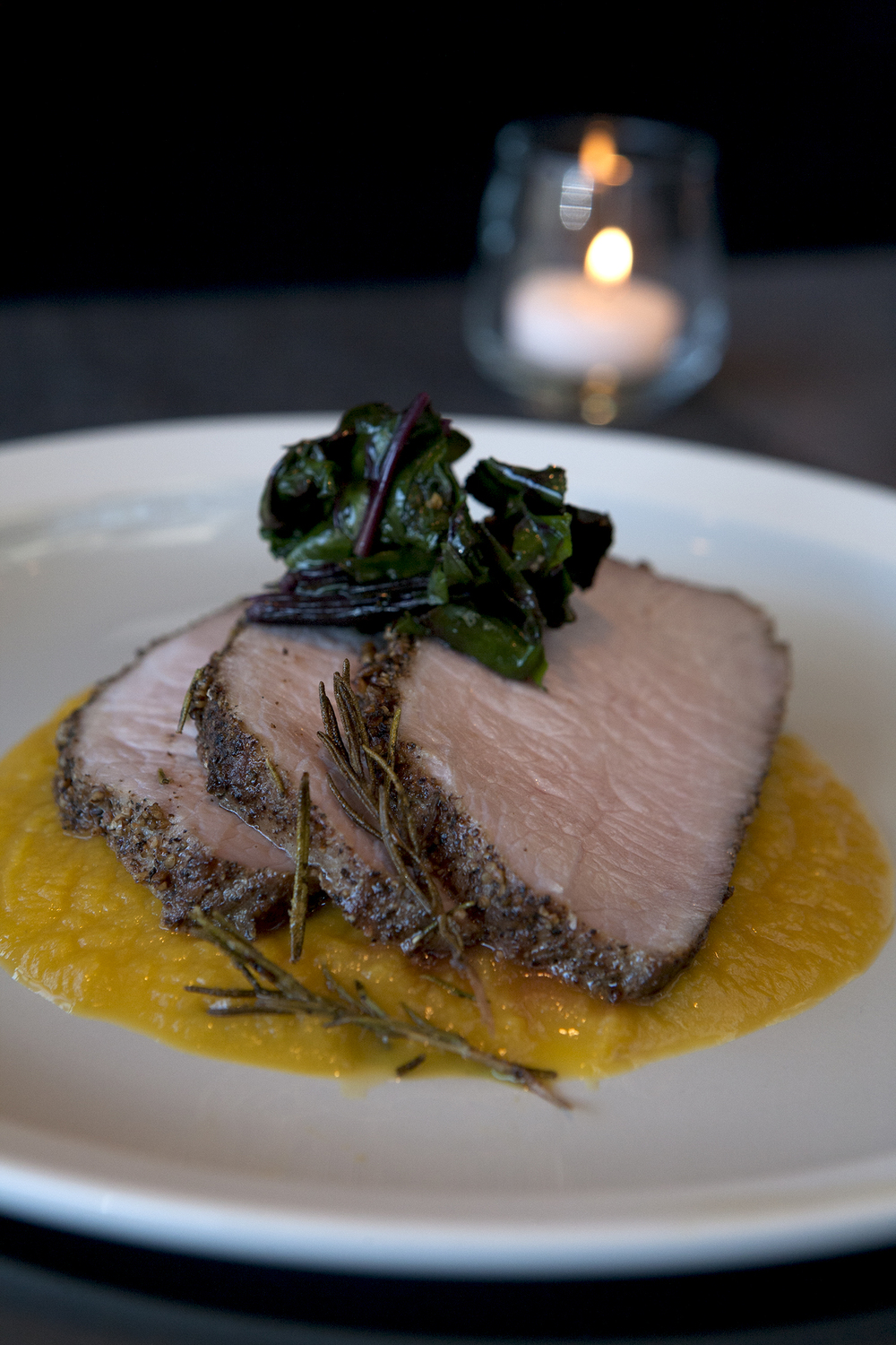 Roast pork loin with butternut squash puree