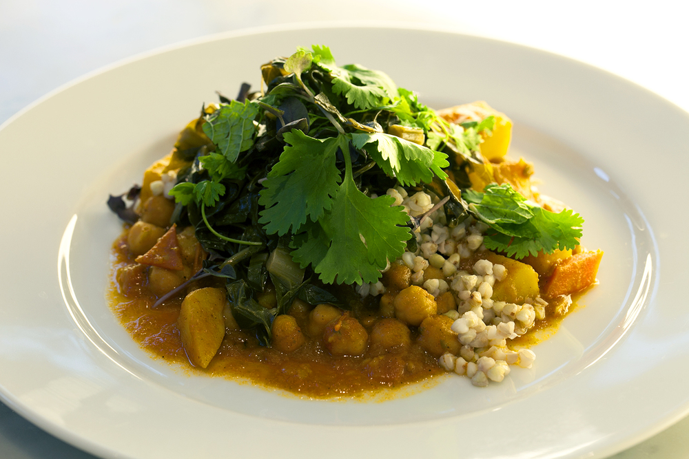 Chickpea and spiced summer veggie stew with buckwheat and slow cooked greens