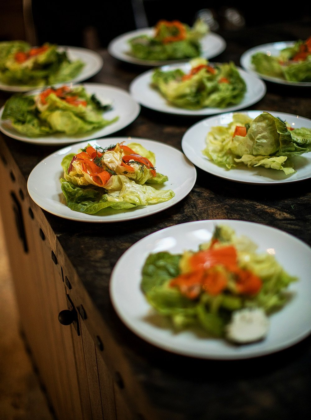 Bibb lettuce salad with carrot, red onion, herb cheese, and dill