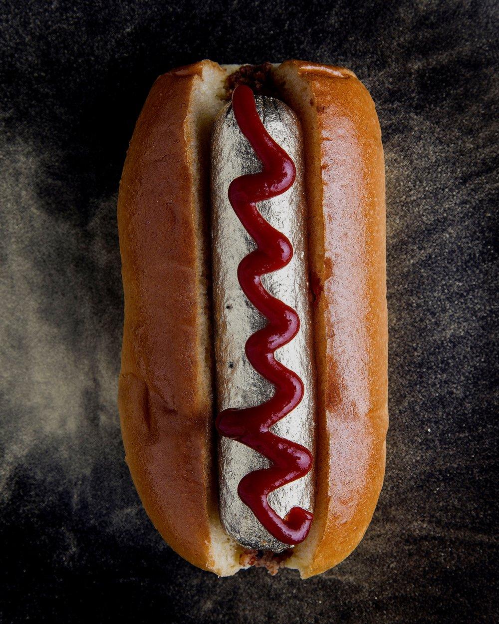 Gold hot dog with ketchup