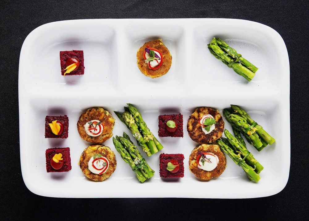 Vegan tv dinner with beetloaf, corn fritter with vegan aioli and anaheim chile, and asparagus