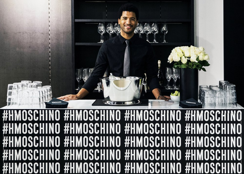 Bartender at custom Moschino x H&M bar