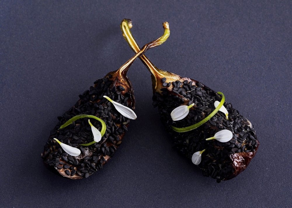 Baby eggplant with sesame seeds, miso glaze and white micro flowers