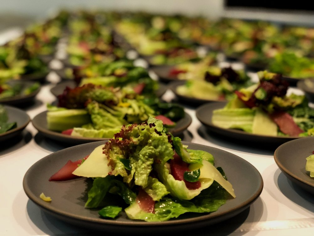 Mixed green salad with conte cheese